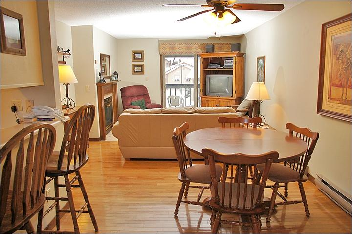 This condo has a warm, comfortable Living Room & Dining Room - Hardwood Foors, Leather Couch, Recliner - Walk or Ride to the Slopes (4392) - Steamboat Springs - rentals
