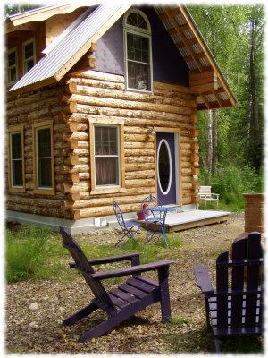 The Moonflower offers an outdoor fireplace. - Talkeetna Cottages Moonflower Cabin - Talkeetna - rentals