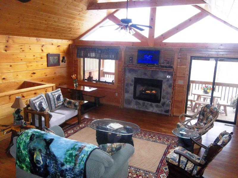 Living Room with a fireplace, hdtv, on demand cable, wireless internet, sleeper sofa, and more - Prime Location Rustic Elegant Mountain Cabin - Gatlinburg - rentals