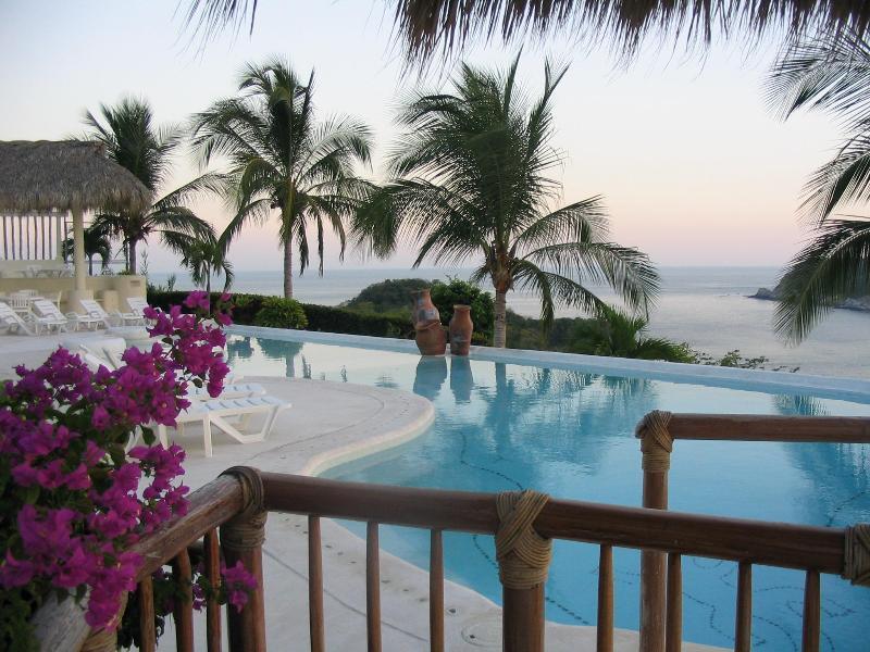 Overlooking the Pool - Casa Alegre Beautiful Oceanfront Condo - Huatulco - rentals