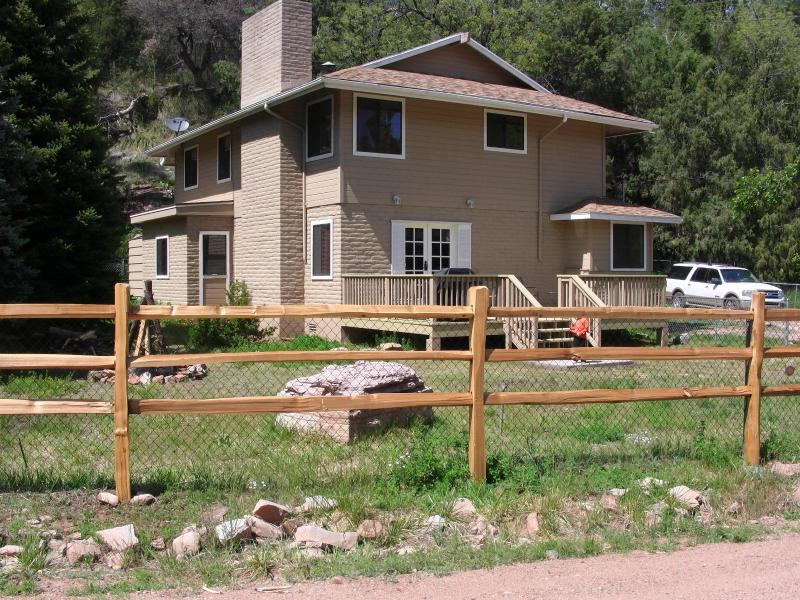 View from Road. Lg Deck and nestled against valley wall with cool pine trees. - East Verde River Cabin: Fish, Hunt & Family Fun - Payson - rentals