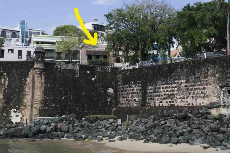 Arrow shows house . Photo taken from pier below.  Bayside walkways can be seen. - 1 of a KIND OLD SJ 2ndFl BayviewApt/ Exclusive St - San Juan - rentals