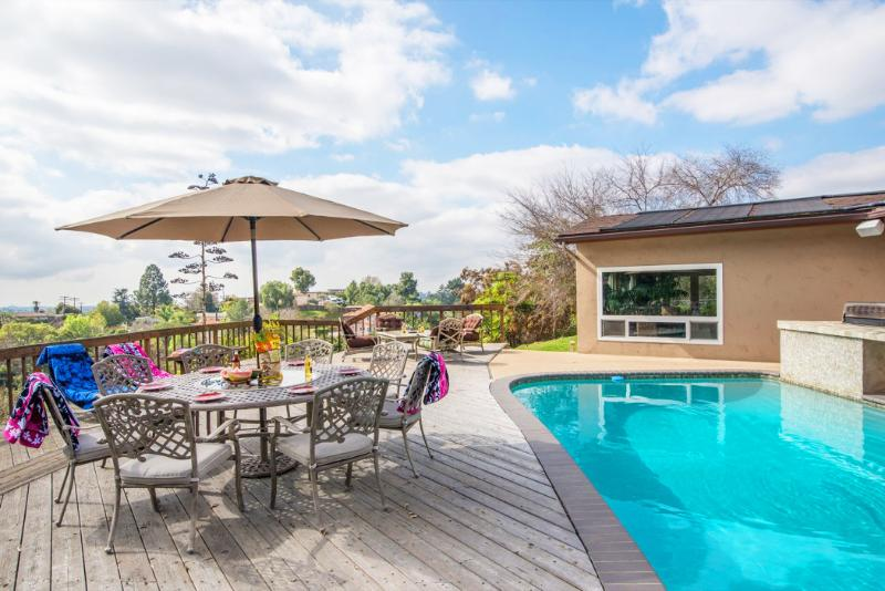 Imagine yourself eating dinner or having a drink after a swim in the pool - 20% off Entertainers Paradise - Best of Everything - Pacific Beach - rentals