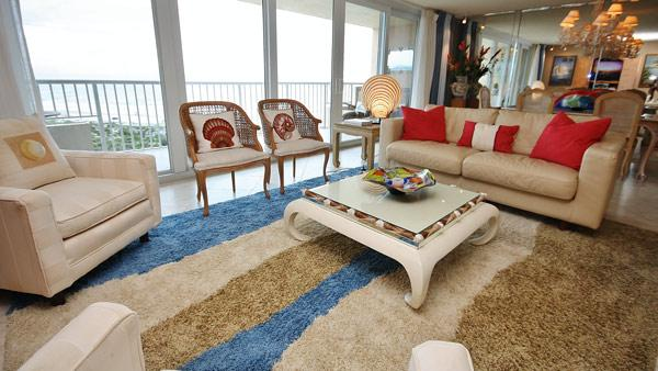 Living Room - Watch the Surfers from Balcony at Inlet at Minorca - New Smyrna Beach - rentals