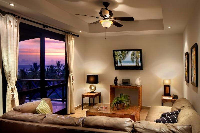 Spacious Living Room with comfy leather sofas - 3 bedroom ocean view condo at Bahia Encantada - Jaco - rentals