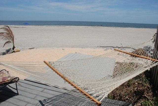 Oceanfront porch on lower level with hammock - 102C Shangri La on The Beach - prices listed may not be accurate - Tybee Island - rentals