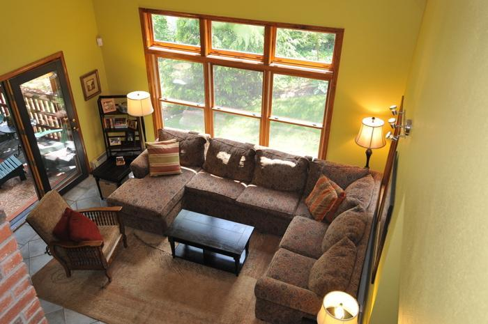 Living Room with cathedral ceiling, 2 story fireplace , SAT TV and attached to screened porch overlooking waterfront - Baby Equipped Lakefront & Sunday River Ski House - Bethel - rentals