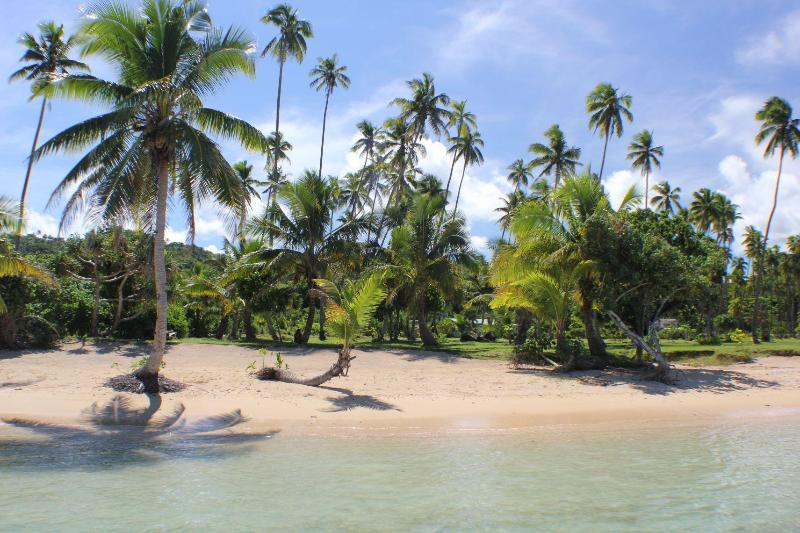 Beach Lounge area is a 1 or 2 minute walk over trimmed green lawns from your Bungalow - SigaSiga Sands COCO Cottage - White Sand Beach! - Savusavu - rentals