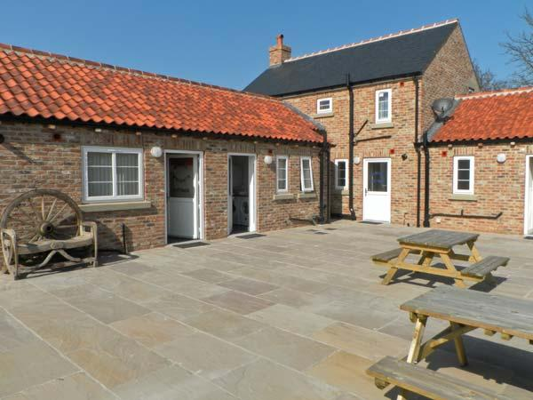 SEA VIEW COTTAGE, red brick cottage, sleeping five people, with woodburning stove, and patio area in Barmston, Ref 12525 - Image 1 - Bridlington - rentals