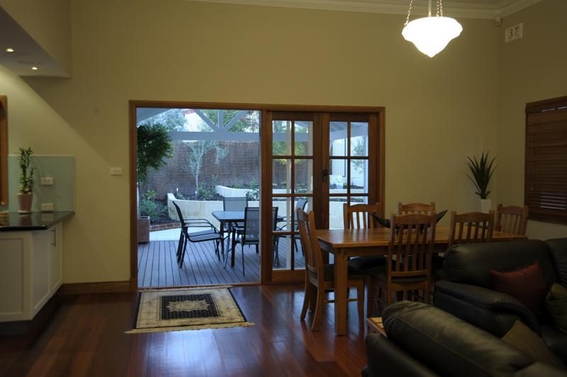 Dining area looking out to patio - Centro Perth Short Stay - Perth - rentals