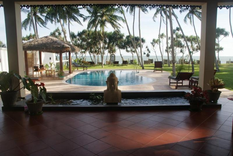 view from terrace over private pool to the beach - Luxurious 4 bedroom beach front villa, pool,staff - Tangalle - rentals