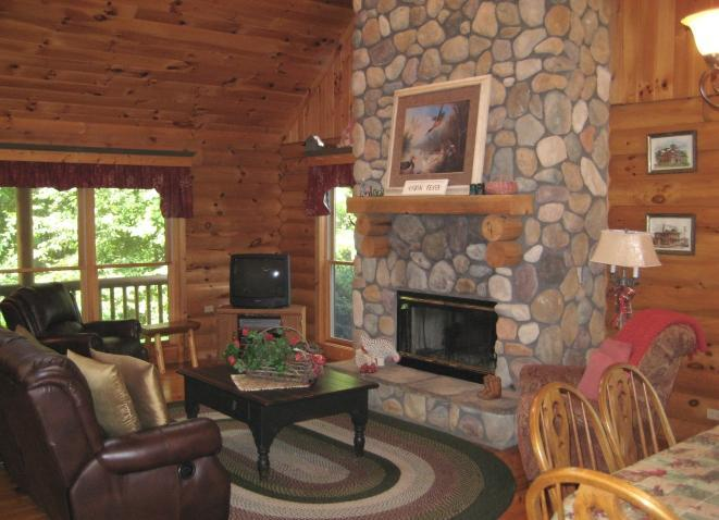 GREAT ROOM with beautiful floor to ceiling boulder fireplace - THE LOG HOUSE  -  ROBERT JOHNSON RENTALS LLC - Galena - rentals