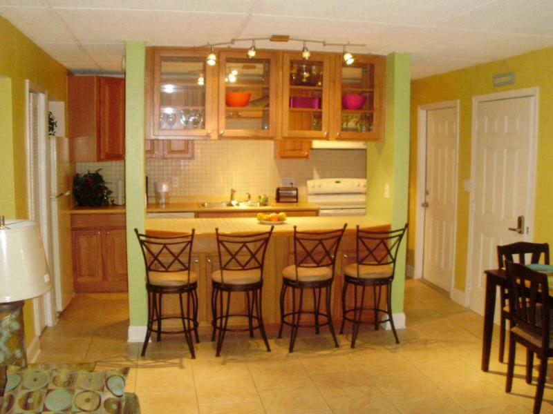The kitchen with breakfast bar - Beautiful Beachside Condo in Cocoa Beach - Cocoa Beach - rentals