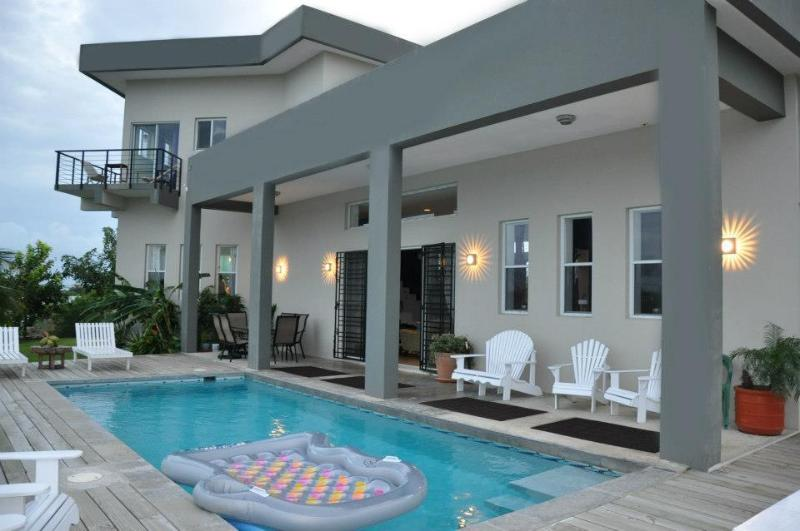 View of Casa Del Mar from the pool deck - Waterfront home, private pool, and FREE vehicle with property - Ladyville - rentals