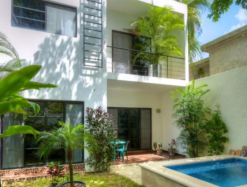 Garden view showing balcony off of master bedroom - Casa Loro -Modern 3BR Villa-Just renovated-Perfect - Cozumel - rentals