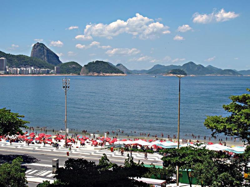 The ocean view as seen from the varanda: Copacabana Beach and Pao de Açucar.  Welcome to Rio! - Ocean view 2 BR with Wi-Fi - Copacabana at Posto 6 - Rio de Janeiro - rentals