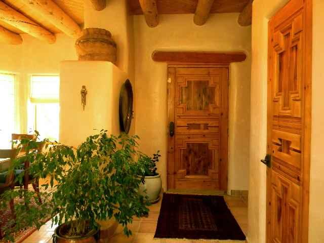 Front foyer door showing hand carved custom crafted solid wood doors throughout - Tristin's House - Taos - rentals