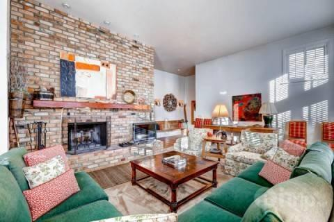 Floor to ceiling brick fireplace add warmth to the space. - Deer Valley Drive Ski Home - Park City - rentals