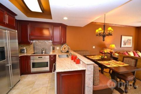 Gourmet kitchen features all stainless steel appliances including french door fridge, oven/stove, dishwasher, microwave and granite counters. Dining r - Westgate 1 Bedroom Suite Solace - Park City - rentals