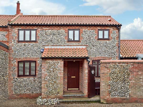 WATERDOWN, flint faced cottage, conservatory and courtyard area, in Sheringham, Ref 15382 - Image 1 - Sheringham - rentals