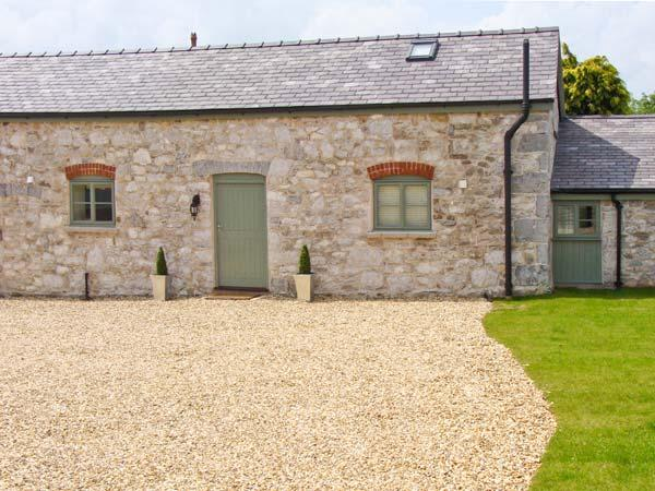THE SHIPPON, one of a group of three, barn conversion in a country village in Rhes-y-Cae Ref 11694 - Image 1 - Gwynedd- Snowdonia - rentals