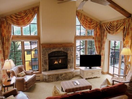 Great room with vaulted ceilings, fireplace, flat screen TV, balcony with mountain views - Austra Haus Club: Mountain View Village Penthouse - Vail - rentals