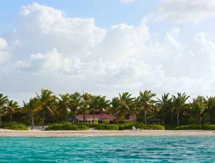 Luxury 4 bedroom Jumby Bay Resort villa. Located directly off the beach! - Image 1 - Antigua and Barbuda - rentals