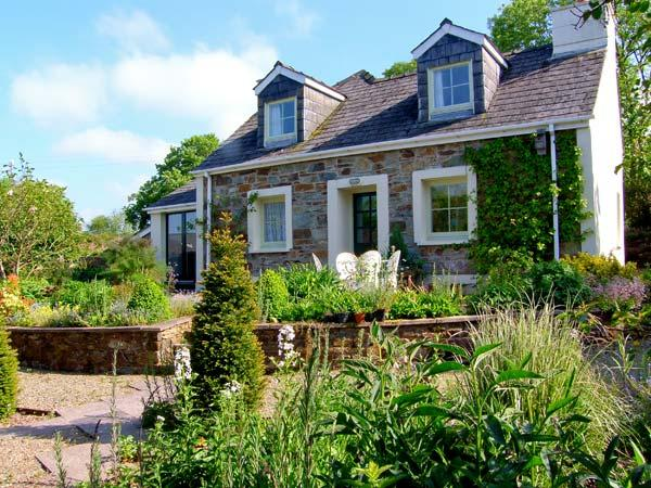 BERIAN CROSS, superb detached cottage, three bedrooms, woodburning stove, enclosed patio, dog friendly, near Newport Sands, Ref 14417 - Image 1 - Pembrokeshire - rentals