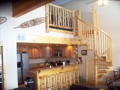 View of Kitchen and Stairwell - Spacious Penthouse Condo - Duck Creek Village - rentals