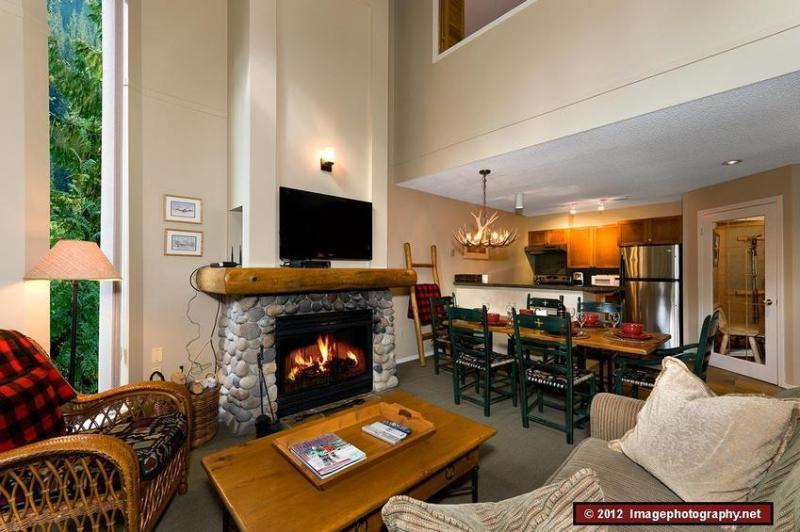 This is the living and dining area and kitchen on the main level. This is a beautifully decorated mountain home with a very friendly and welcoming feeling. - The Gables: BEST central location, close to all lifts, quiet & beautiful - Whistler - rentals
