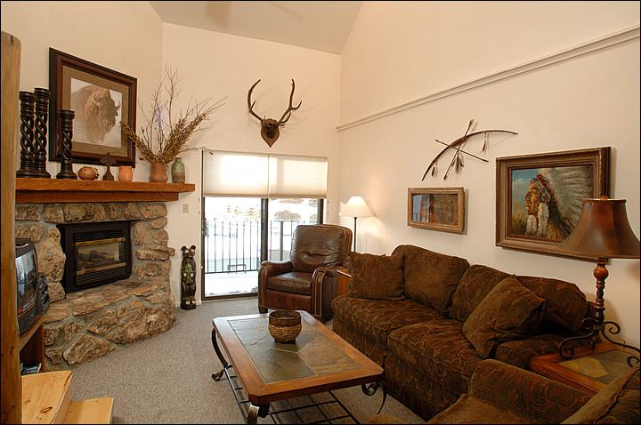 Living Room Includes a Fireplace and Opens up to a Private Balcony (Representative Unit) - Charming Condo with Great Views - Perfect for Winter and Summer Trips (1122) - Crested Butte - rentals