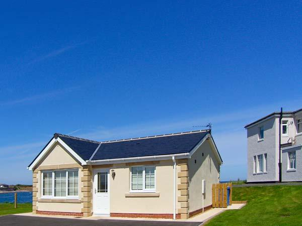WHITE ROCK COTTAGE, on the coast, stunning sea views, off road parking, with a patio garden, in Beadnell, Ref 17790 - Image 1 - Beadnell - rentals