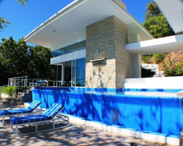 Front terrace with water wall from pool. - Luxury MODERN Villa  Wow Terraces & Ocean views - San Juan del Sur - rentals