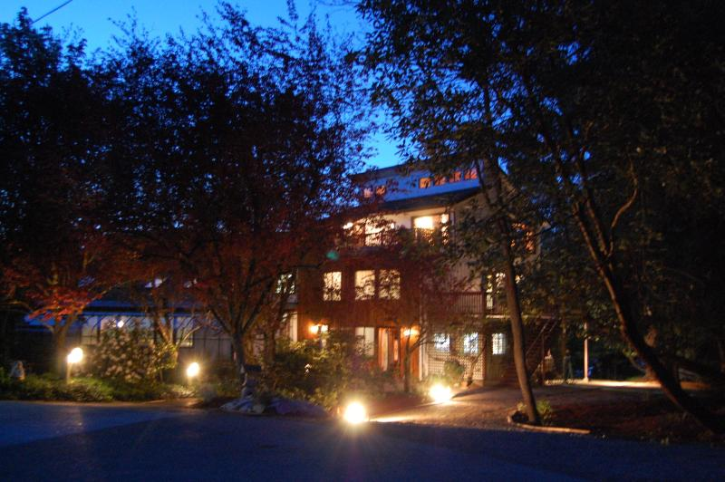 Front of house at dusk - Oceanfront Self-Contained House - Cowichan Bay - rentals