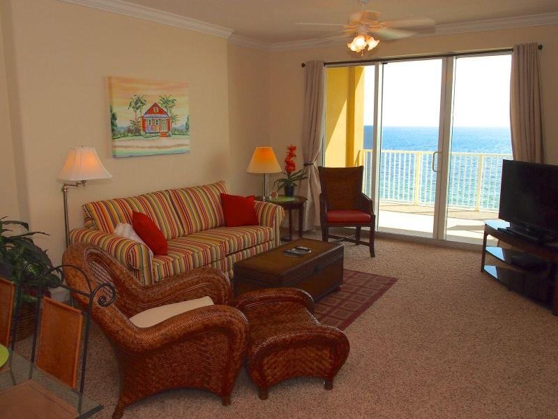Bright and cheery living room - 2 Bedroom on the Beach with Private Balcony at Tropic Winds - Panama City Beach - rentals