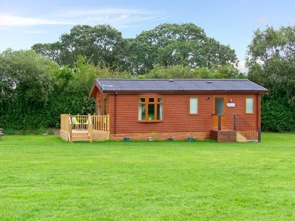 SYCAMORE LODGE, detached timber chalet, with two bedrooms, en-suite bathroom, and decked area, in Hinstock, Ref 19308 - Image 1 - Hinstock - rentals