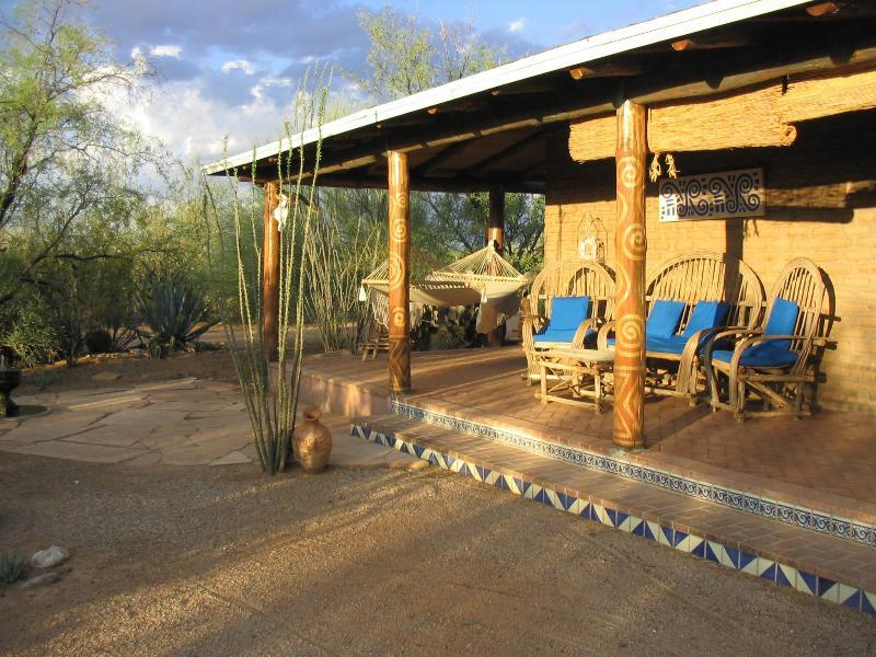 Enjoy morning coffee and bird watching on the Sunrise Porch - HACIENDA TUCSON - Adobe near Saguaro National Park West - Tucson - rentals