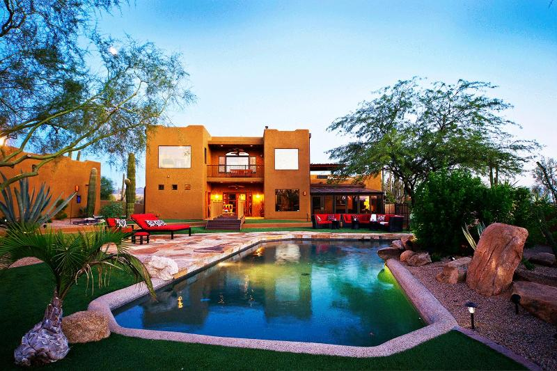 breathtaking view of backyard and the back of the house during dusk. - AWESOME 5 Star Luxury Estate Resort Style Backyard - Scottsdale - rentals