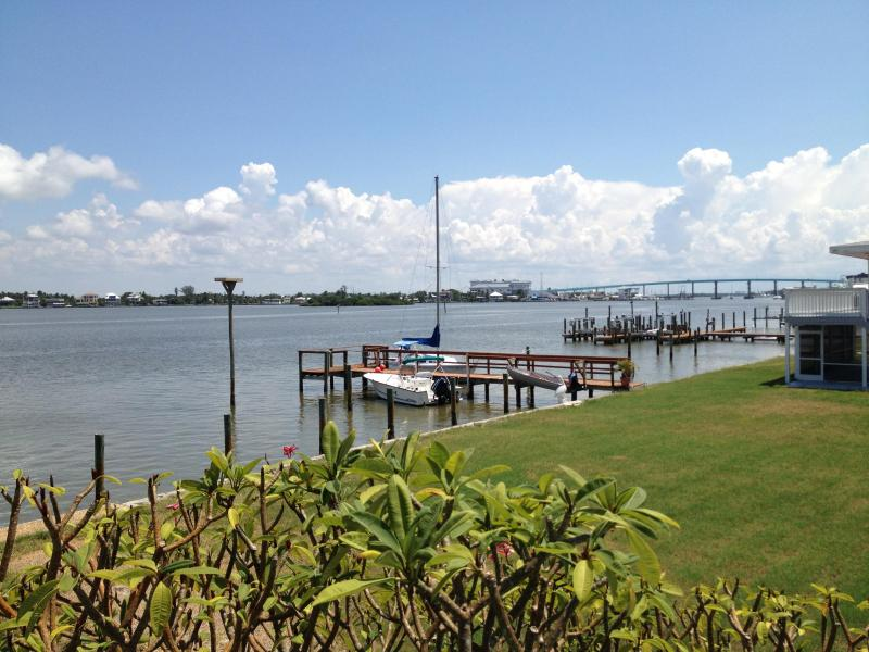 Imagine sitting on the deck watching the dolphins play - Charming beach cottage located on Estero Bay. - Fort Myers Beach - rentals
