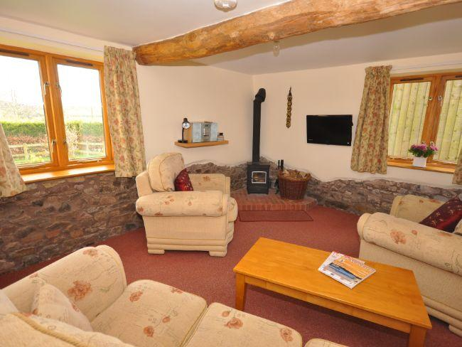 Lounge area with exposed beams, stonework and woodburner - WOODB - Cheriton Fitzpaine - rentals