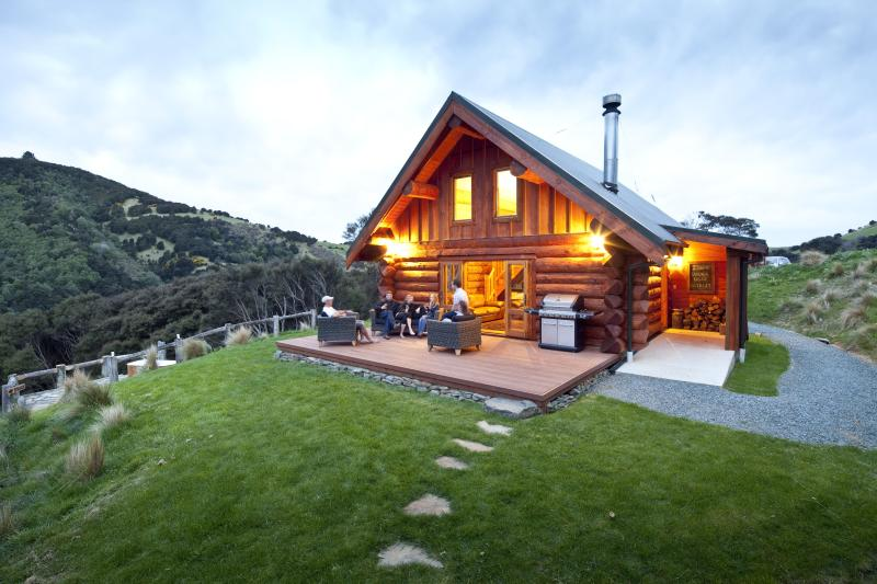 Cascade Creek Retreat at dusk - Secluded, private log chalet in native bush valley - Dunedin - rentals