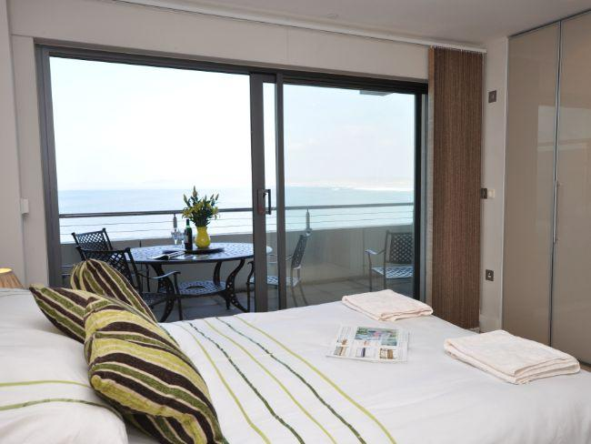 En-suite double bedroom leading to private balcony with stunning sea views - NASSA - Westward Ho - rentals