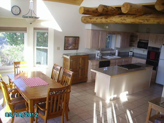 Dining Room opens up into the kitchen with a nice kitchen island and stove top. - Secluded Animas River View Retreat - Durango - rentals