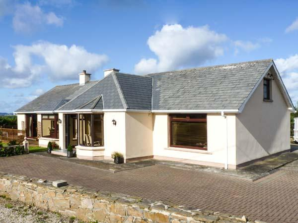 STRAND COTTAGE, pet friendly, open fires, en-suite, sea views in Derrybeg, Ref 15997 - Image 1 - Gaoth Dobhair (Gweedore) - rentals