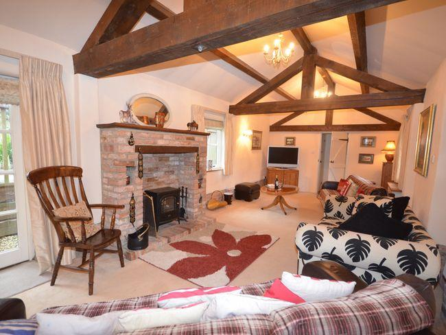 Lounge with exposed beams and woodburner effect fire - THEAU - Dorset - rentals