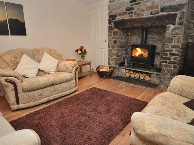 Lounge with woodburner and door to covered decking and garden - BEEHI - Bradworthy - rentals