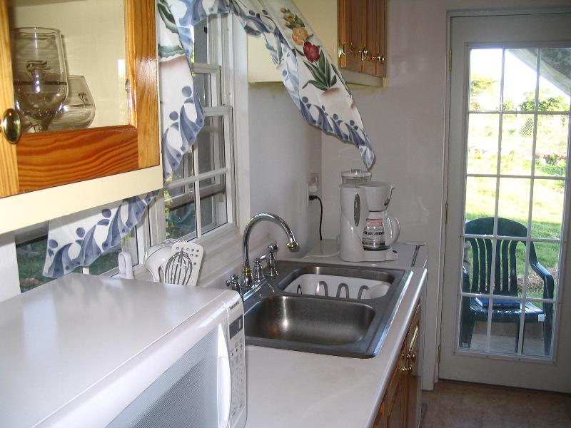 The Kitchen area within the apartment - Coconut House Conveniently Located with AC, WiFi - Charlestown - rentals
