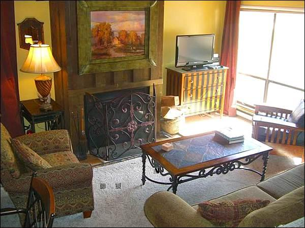 Spacious and Sunny Living Room Features a Flat-Screen TV and Fireplace - Wonderful Whetstone Condo - Next to the Silver Queen Lift (1359) - Crested Butte - rentals