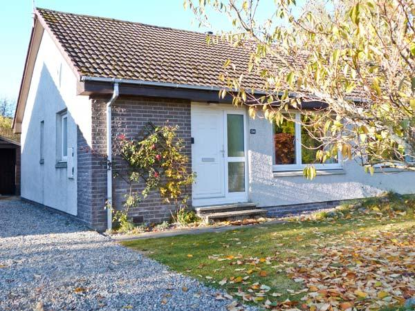 STEAM COTTAGE, single-storey accommodation, woodburner, conservatory, enclosed garden, near Aviemore, Ref 20262 - Image 1 - Aviemore - rentals