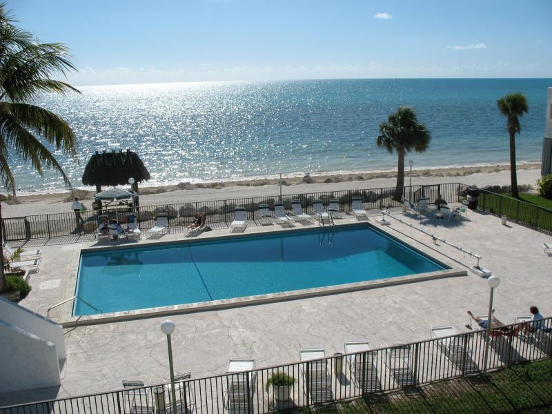 Ocean view of pool & beach from private balcony - Ocean Front Condo on Sandy Beach in center FL Keys - Marathon - rentals